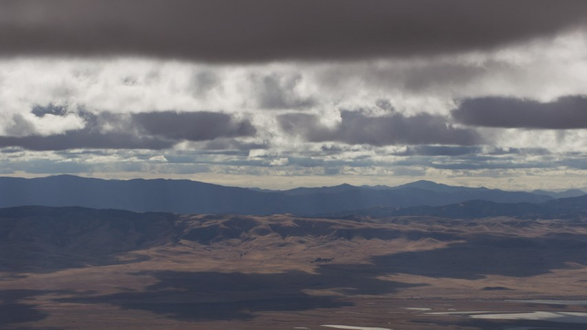 Clouds over desert hills and mountains in Southern California Aerial Stock Footage | AF0001_001012