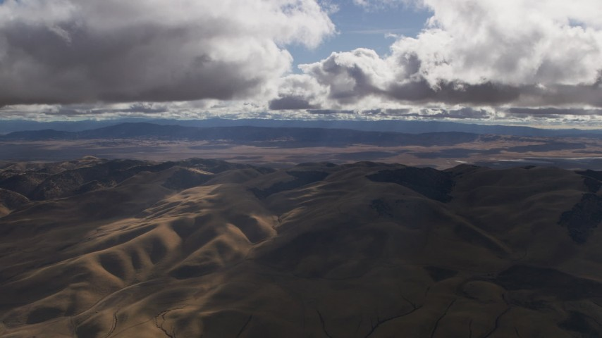 Godrays and clouds over desert hills in Southern California Aerial Stock Footage | AF0001_001014