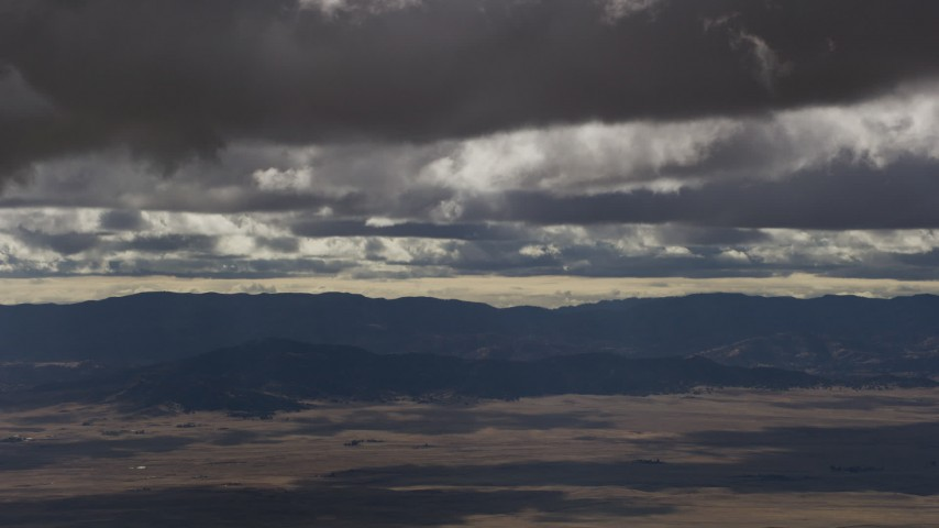 Thick clouds over desert and mountain ridges in Southern California Aerial Stock Footage | AF0001_001018