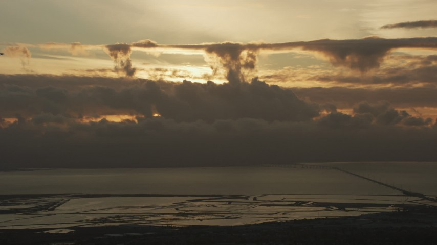 8K stock footage aerial video of cloud formations over San Francisco Bay and San Mateo Bridge at sunset in California Aerial Stock Footage | AF0001_001035