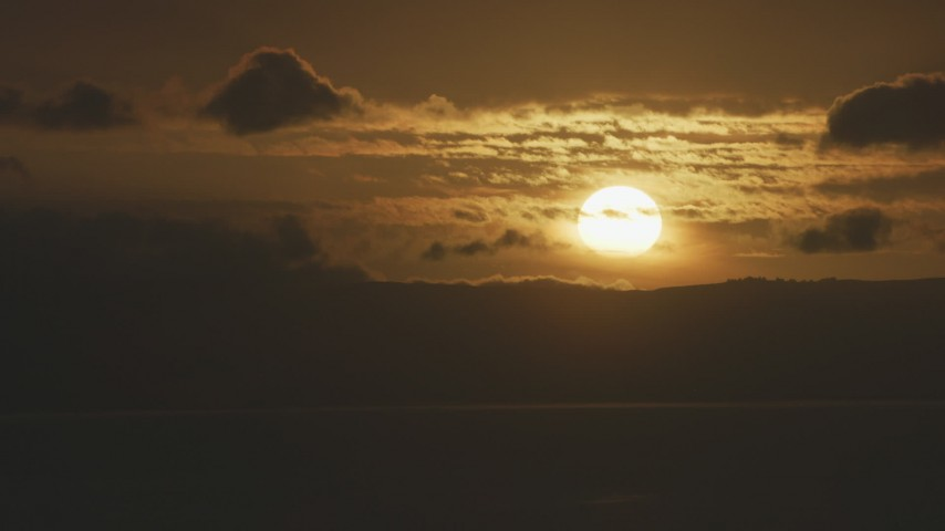 8K stock footage aerial video of the sun setting behind clouds in Northern California Aerial Stock Footage | AF0001_001041