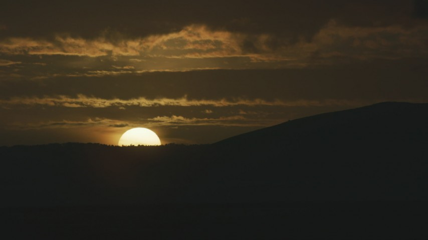 8K stock footage aerial video of the setting sun behind a mountain ridge in Northern California Aerial Stock Footage | AF0001_001044