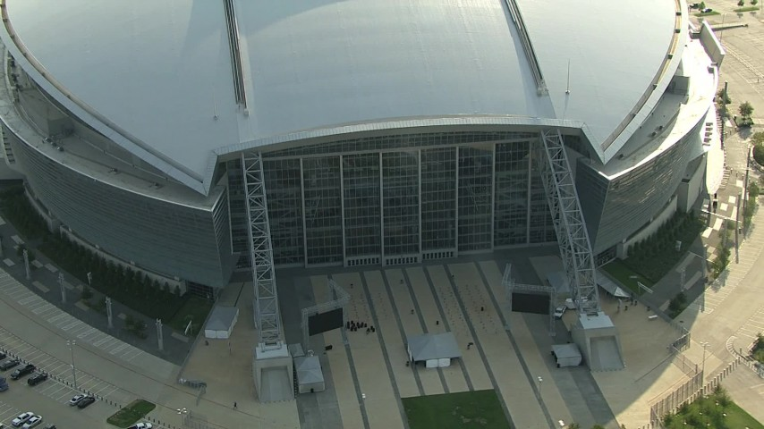 1080 stock footage aerial video flying by side of AT&T Stadium, pull back, orbit the stadium, Arlington, Texas Aerial Stock Footage | AI05_DAL_18