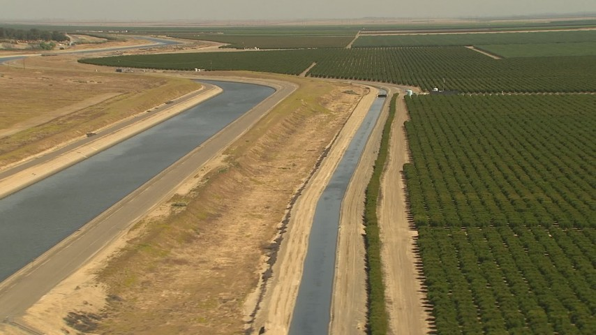 1080 stock footage aerial video flyby aqueduct, fields of crops Central Valley, California Aerial Stock Footage | AI06_FRM_010