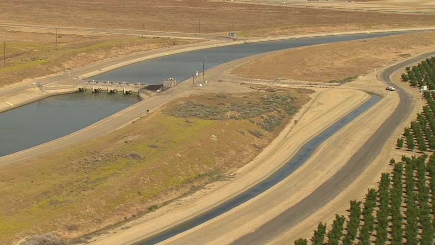 1080 stock footage aerial video canal and dam near farmland, Central Valley, California Aerial Stock Footage | AI06_FRM_011