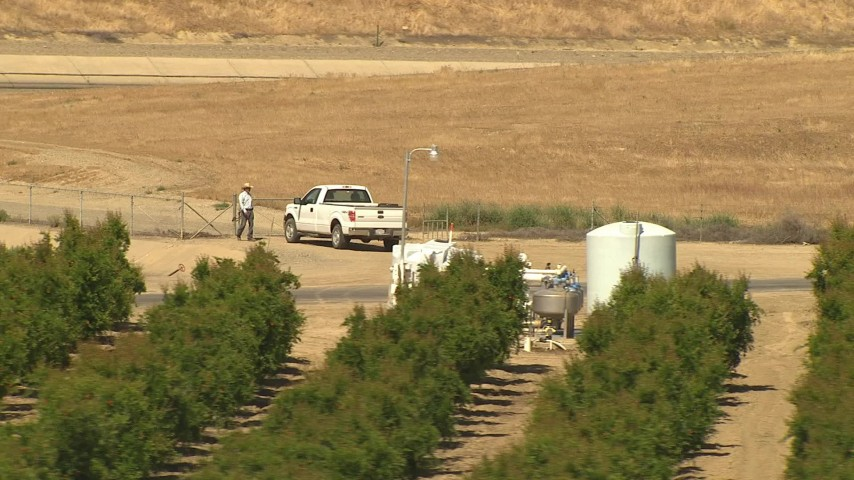 1080 aerial stock footage video a man getting into his truck, near aqueduct and orchard, Central Valley, California Aerial Stock Footage | AI06_FRM_027