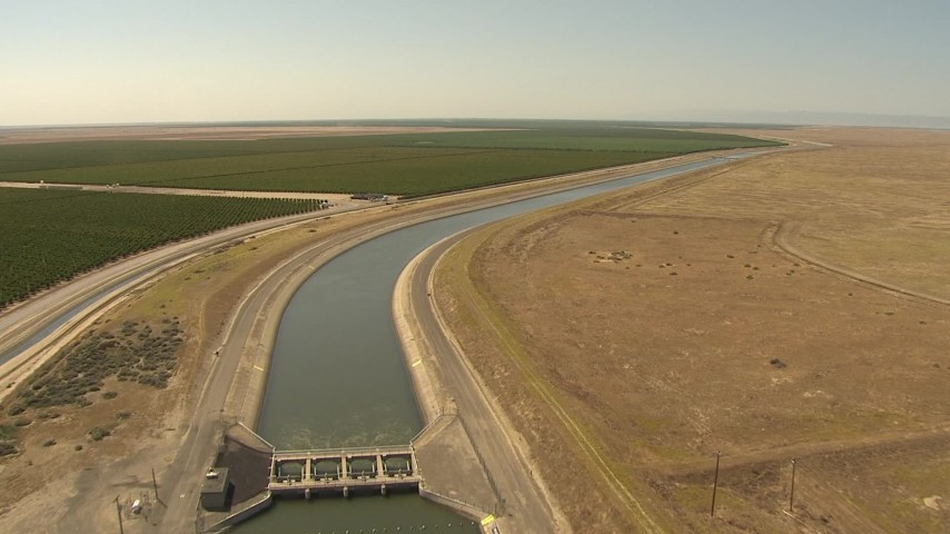 1080 stock footage aerial video following an aqueduct between orchards and open fields, Central Valley, California Aerial Stock Footage | AI06_FRM_060