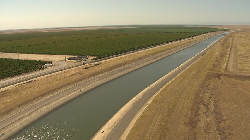 1080 stock footage aerial video follow aqueduct between crops and open fields, Central Valley, California Aerial Stock Footage | AI06_FRM_061