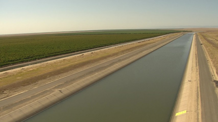 1080 stock footage aerial video descending low toward aqueduct, Central Valley, California Aerial Stock Footage | AI06_FRM_063