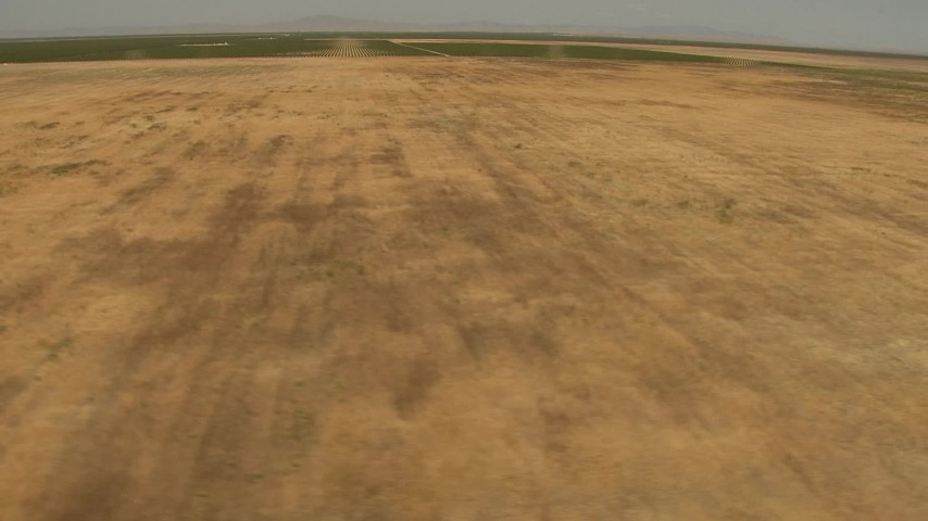 1080 stock footage aerial video flying by open fields, Central Valley, California Aerial Stock Footage   AI06_FRM_107