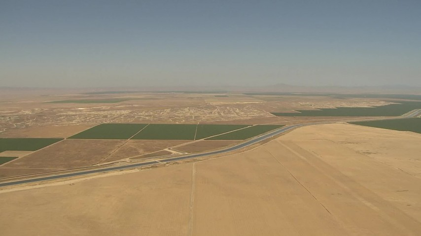 1080 stock footage aerial video flying high over farmland, aqueduct, Central Valley, California Aerial Stock Footage | AI06_FRM_111