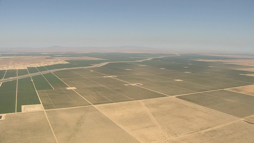 1080 stock footage aerial video of a wide view of farmland and aqueduct, Central Valley, California Aerial Stock Footage | AI06_FRM_112