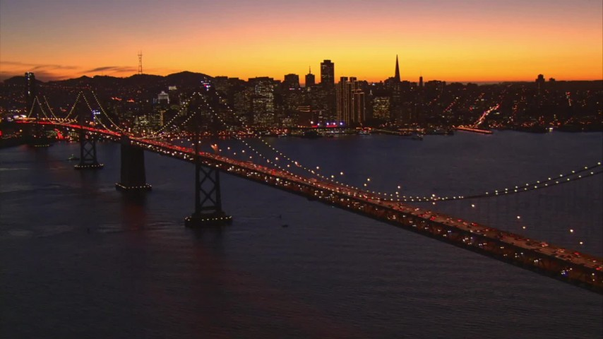 1080 stock footage aerial video flyby Bay Bridge with a view of Downtown San Francisco, California, twilight Aerial Stock Footage | AI08_SF1_13