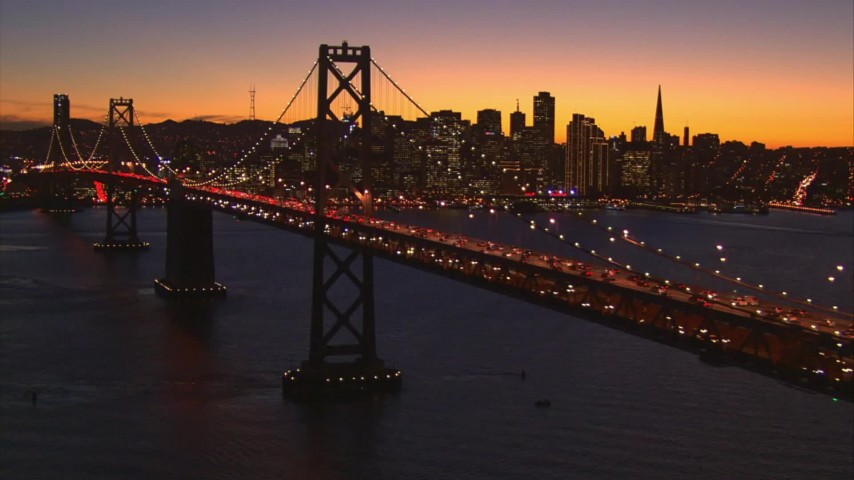 1080 stock footage aerial video of the Bay Bridge with Downtown San Francisco, California, behind it at twilight Aerial Stock Footage | AI08_SF1_15