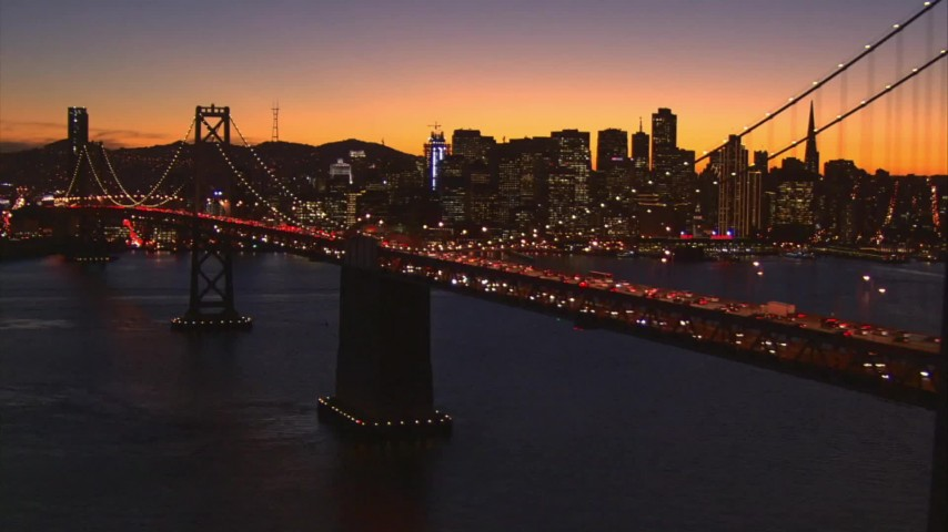 1080 aerial video flyby Bay Bridge with a view of Downtown San Francisco, California, sunset  Aerial Stock Footage | AI08_SF1_16