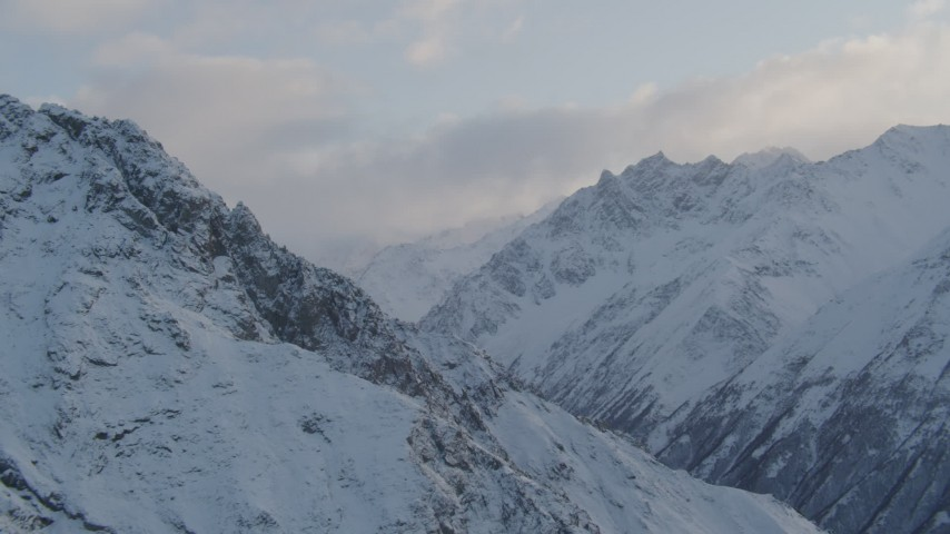 4K stock footage aerial video snow-covered Chugach Mountains, clouds, Chugach National Forest, Alaska Aerial Stock Footage | AK0001_0003