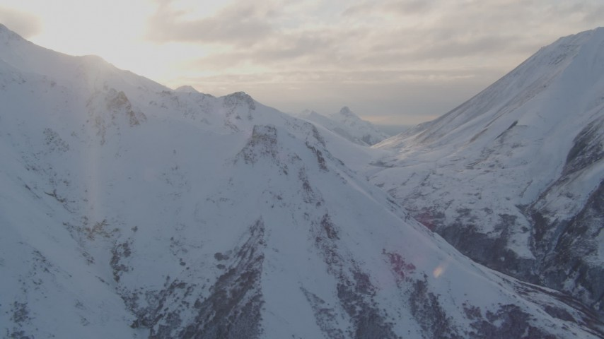 4K stock footage aerial video pan left by snow covered Chugach Mountains, Chugach National Forest, Alaska Aerial Stock Footage | AK0001_0004