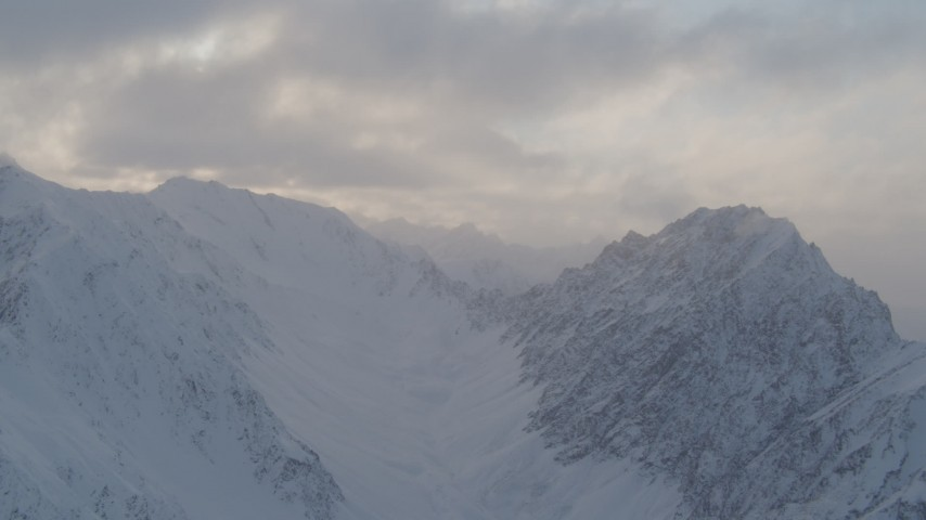 4K stock footage aerial video snow-covered Chugach Mountains, clouds, Chugach National Forest, Alaska Aerial Stock Footage | AK0001_0007