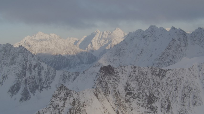 4K stock footage aerial video snow-covered Chugach Mountains. low clouds, Chugach National Forest, Alaska Aerial Stock Footage | AK0001_0008