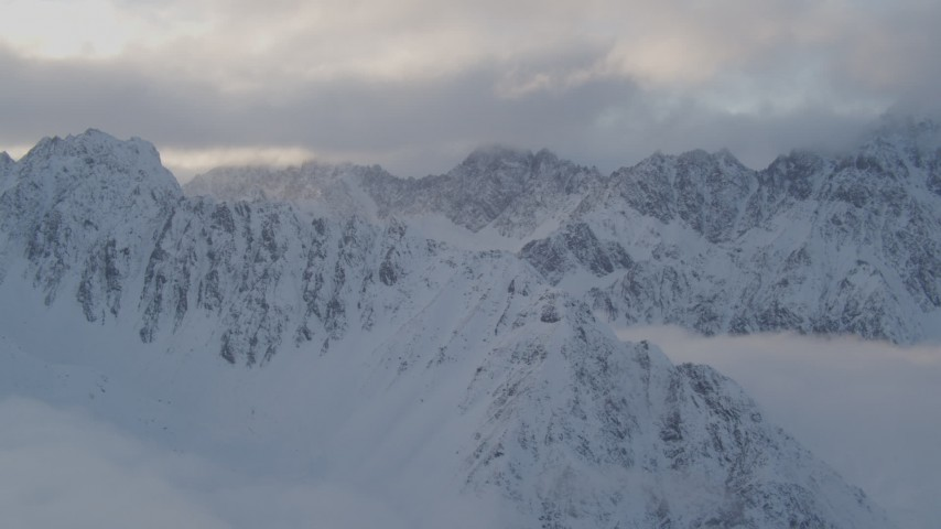 4K stock footage aerial video snow covered Chugach Mountains, clouds, Chugach National Forest, Alaska Aerial Stock Footage | AK0001_0013