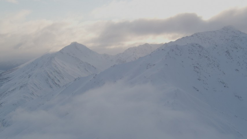 4K stock footage aerial video flying by snow covered Chugach Mountain peaks, Chugach National Forest, Alaska Aerial Stock Footage   AK0001_0015