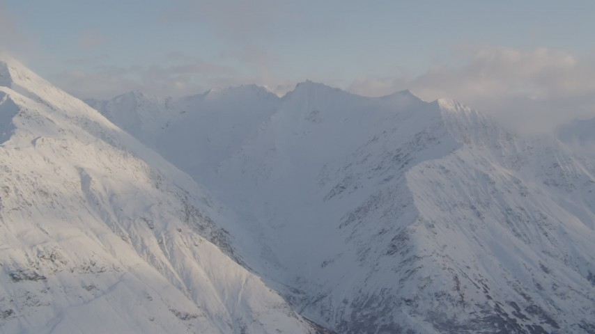 4K stock footage aerial video flying by snow covered Chugach Mountain peaks, Chugach National Forest, Alaska Aerial Stock Footage | AK0001_0016