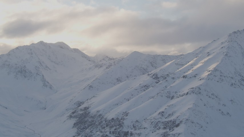 4K stock footage aerial video snow covered peaks, clouds, Chugach Mountains, Chugach National Forest, Alaska Aerial Stock Footage | AK0001_0017