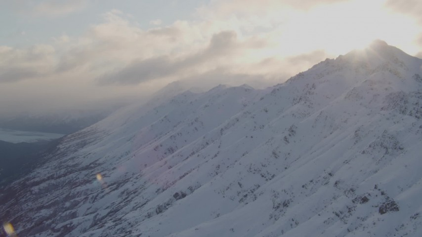 4K aerial video pan across Chugach Mountain peaks, clouds, Chugach National Forest, Alaska Aerial Stock Footage | AK0001_0018