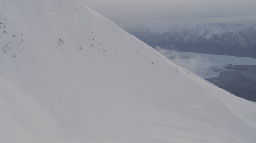 4K aerial video approach snow covered ridge, Chugach Mountains, Chugach National Forest, Alaska Aerial Stock Footage | AK0001_0021