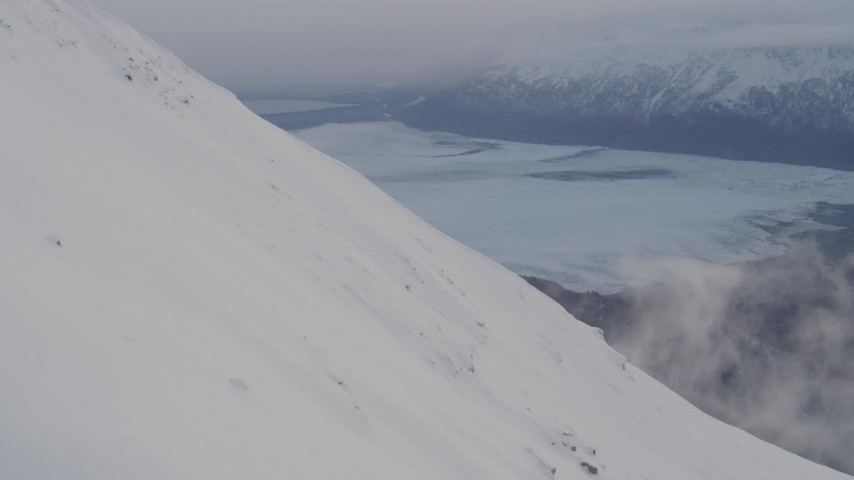 4K stock footage aerial video snowy slope, Knik Glacier, Inner Lake George, Chugach National Forest, Alaska Aerial Stock Footage | AK0001_0022