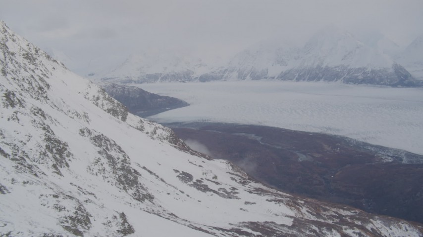 4K stock footage aerial video pan right by Knik Glacier and Chugach Mountains, Knik Glacier, Alaska Aerial Stock Footage | AK0001_0023