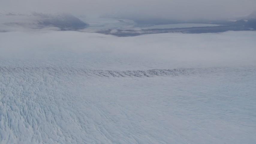 4K stock footage aerial video tilting up to reveal Knik Glacier, distant mountains, Knik Glacier, Alaska Aerial Stock Footage | AK0001_0026