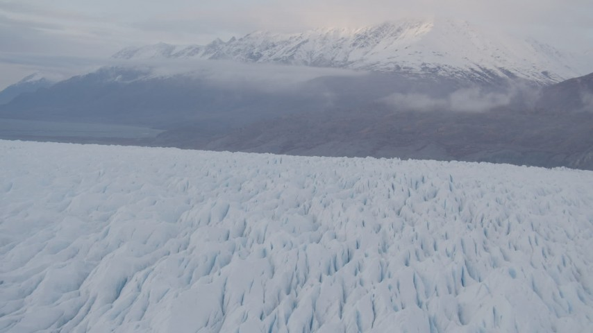 4K stock footage aerial video flying low over Knik Glacier, tilt down to close up of the surface, Knik Glacier, Alaska Aerial Stock Footage | AK0001_0028