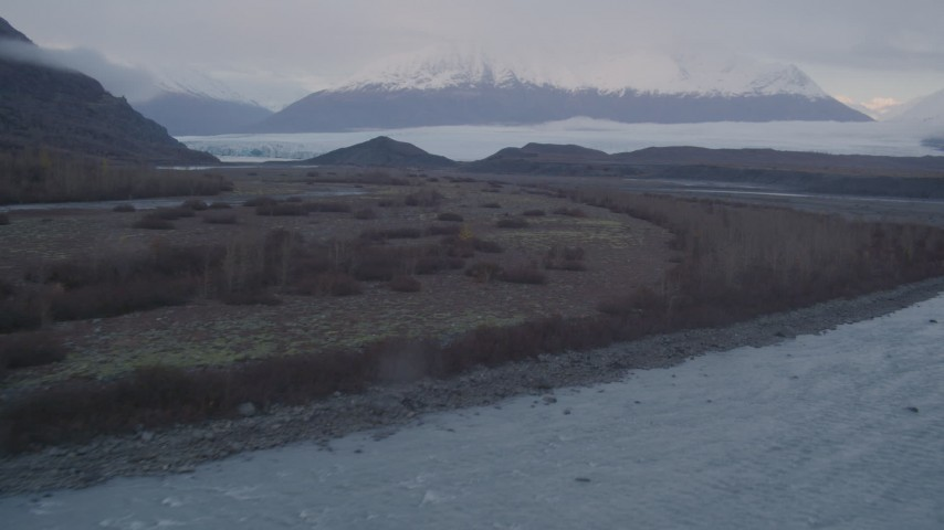 4K stock footage aerial video approaching glacier, distant snow covered mountains, Knik, Alaska Aerial Stock Footage | AK0001_0046