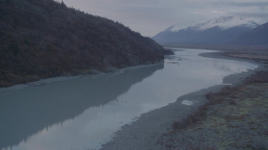 4K stock footage aerial video following a river, approaching a valley, Chugach Mountains, Knik, Alaska Aerial Stock Footage | AK0001_0058