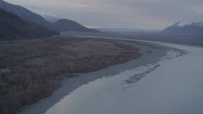 4K stock footage aerial video following a river, approaching a valley, Chugach Mountains, Knik, Alaska Aerial Stock Footage | AK0001_0059