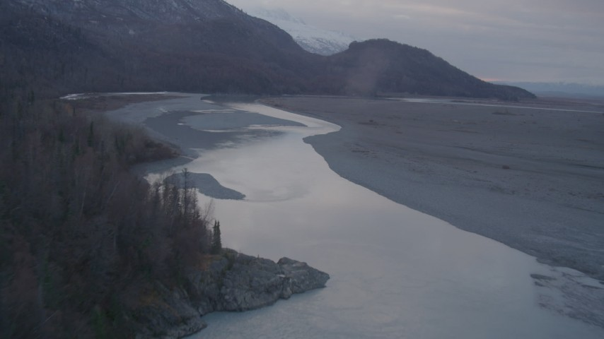 4K stock footage aerial video flying over countryside, river, approaching valley, Chugach Mountains, Knik, Alaska Aerial Stock Footage | AK0001_0060