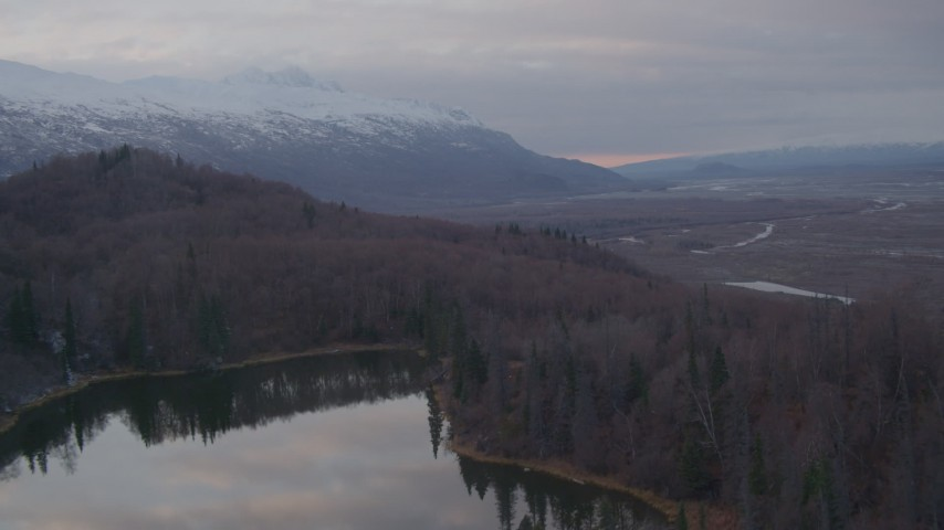 4K stock footage aerial video over foothills, reveal lake, valley, Chugach Mountains, Knik River Valley, Alaska Aerial Stock Footage | AK0001_0064