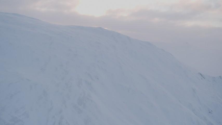 4K stock footage aerial video approaching summit of a snowy peak, Chugach Mountains, Alaska Aerial Stock Footage   AK0001_0076