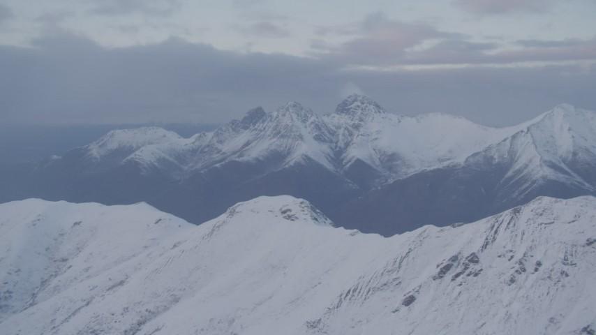 4K stock footage aerial video snow capped Chugach Mountains, clouds, Chugach Mountains, Alaska, sunset Aerial Stock Footage | AK0001_0077