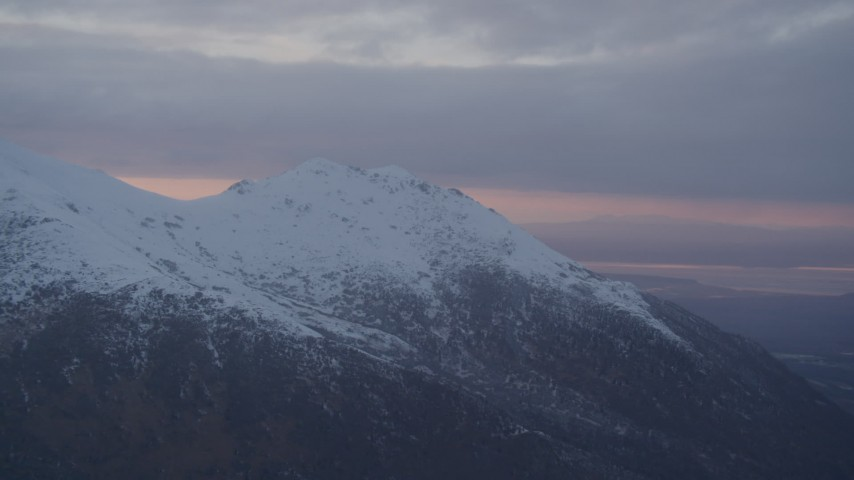 4K stock footage aerial video flyby by snow capped mountain peak, Chugach Mountains, Alaska, sunset Aerial Stock Footage | AK0001_0088