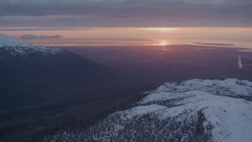 4K aerial video pan left by Anchorage, seen from Chugach Mountains, Alaska, sunset Aerial Stock Footage AK0001_0093