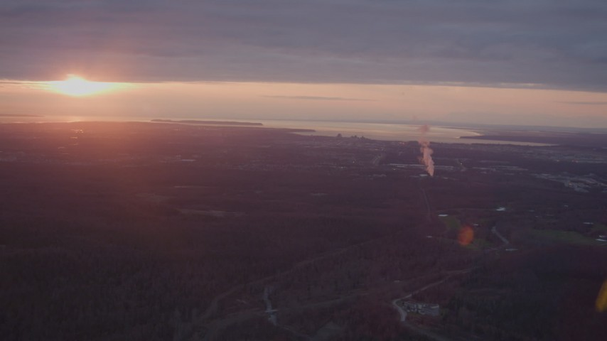 4K stock footage aerial video pan across Anchorage, power plant, reveal setting sun, Anchorage, Alaska, sunset Aerial Stock Footage | AK0001_0097