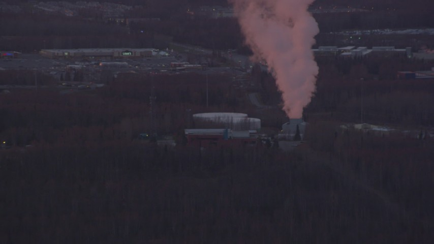 4K stock footage aerial video approaching a power plant, Anchorage, Alaska, sunset Aerial Stock Footage | AK0001_0099