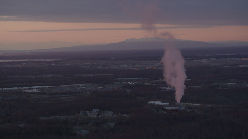 4K stock footage aerial video flyby power plant, zoom to reveal Downtown Anchorage, Alaska, sunset Aerial Stock Footage | AK0001_0100