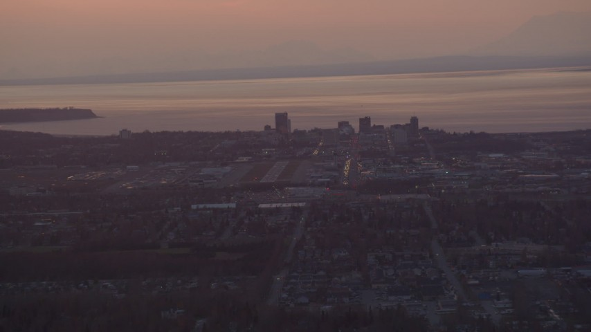 4K stock footage aerial video approaching Merrill Field and Downtown Anchorage, Alaska, sunset Aerial Stock Footage | AK0001_0101