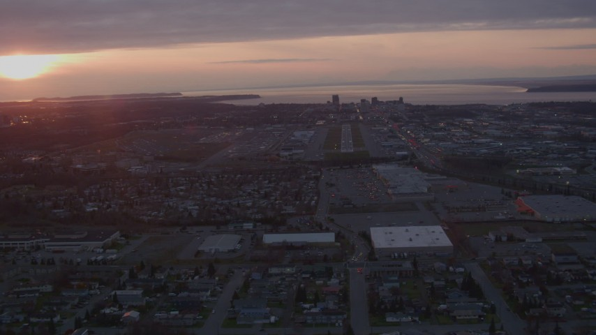 4K stock footage aerial video approaching Merrill Field and Downtown Anchorage, Alaska, sunset Aerial Stock Footage | AK0001_0104