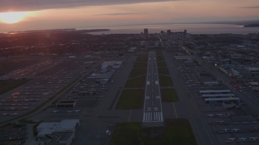 4K stock footage aerial video flying over Merrill Field, approaching Downtown Anchorage, Alaska, sunset Aerial Stock Footage | AK0001_0105