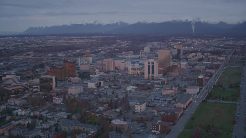 4K stock footage aerial video orbit Downtown, Chugach Mountains, Downtown Anchorage, Alaska, twilight Aerial Stock Footage | AK0001_0108