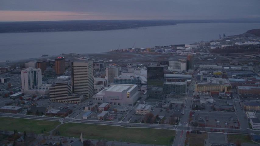 4K stock footage aerial video orbiting Downtown buildings, Downtown Anchorage, Alaska, twilight Aerial Stock Footage | AK0001_0109